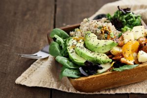 Quinoa, avocado and apple salad. Perfect for the detox diet or just a healthy meal. Selective focus on front of dish with extreme shallow depth of field.